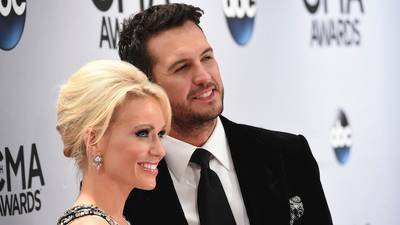 Luke Bryan's wife Caroline once slept on a makeshift bed of suitcases on his tour bus
